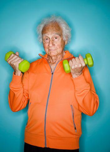Stock Photo : Happy Senior Man Lifting Weights in Orange Coat