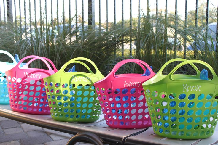 Pool party favors: beach baskets, inflatable dolphins, personalized cups
