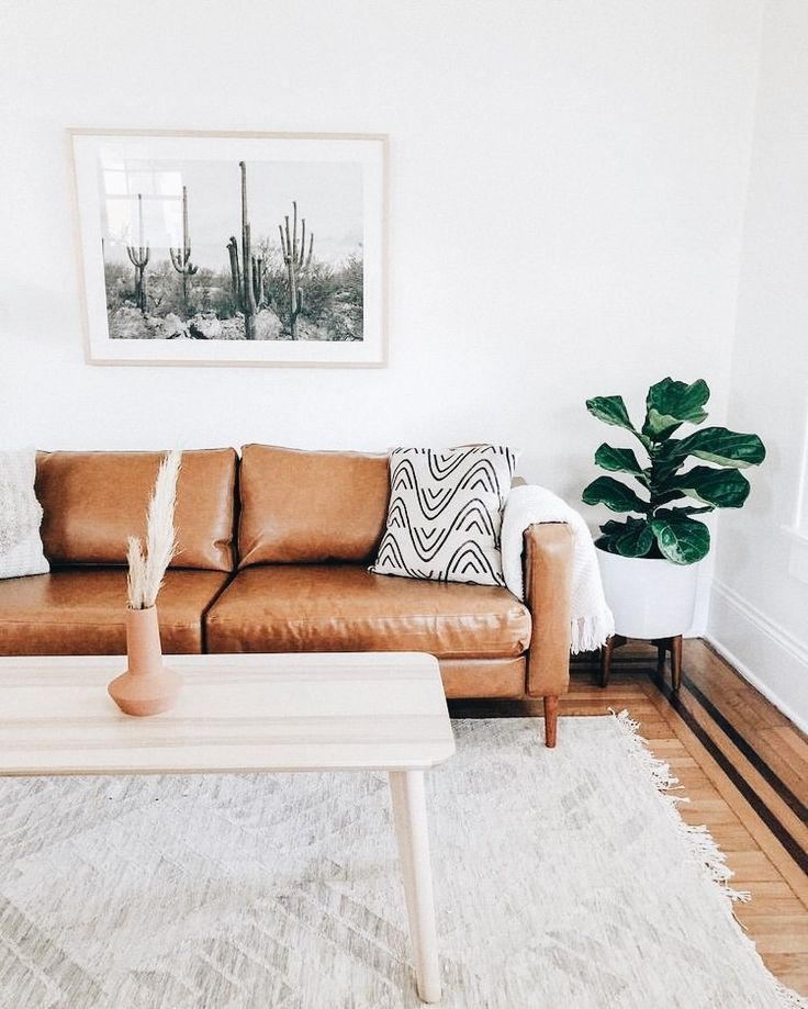 Cactus Print In White Frame Above Cognac Leather Couch With White
