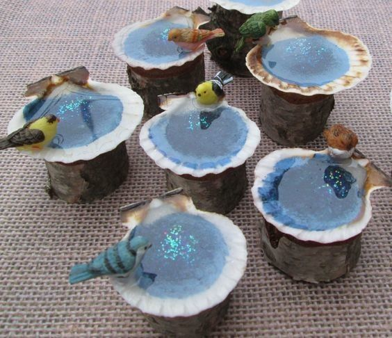 Genuine sea shells and a dash of glitter make for such pretty little bird baths. Found here.