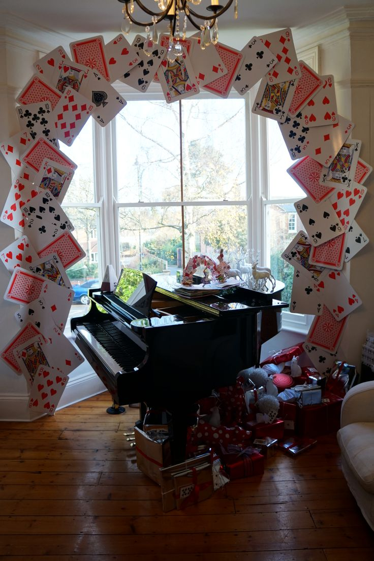 How cool of we made giant playing cards to symbolize a fortune teller at the circus and did a pattern like they were flying of the wall? Or we could hang them?