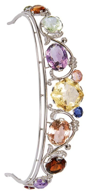 A rare Jugendstil white gold, diamond and gem-set tiara, circa 1920. Set with pink, green and yellow tourmalines, amethysts, citrine, smoky quartz, yellow-green and yellow heliodors, sapphire and diamonds. #Jugendstil