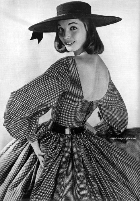 I love this back neckline! Dramatic! (via http://myvintagevogue.tumblr.com) #50s #dress #vintage