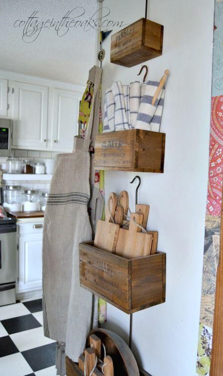 Cute farmhouse kitchen idea for storage for cutting boards and what not. #farrmhouse #farmhousekitchen #storageideas