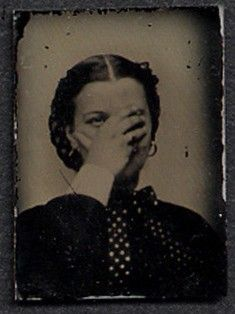 Unusual tintype of a woman with her hand over her face.