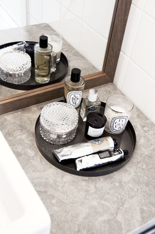 If your not an overly feminine woman or you want a way to organize your mans grooming products this is a great option. Make it what you want. You could also spray paint a plain tray a pretty pink if you wanted and glue on some trim from the notions department if you wanted to make it more feminine. Take it for what you will, as an inspiration to make your own that fits you.