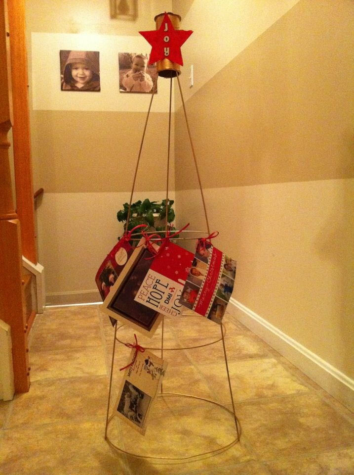 Christmas card holder made out of a tomato cage.