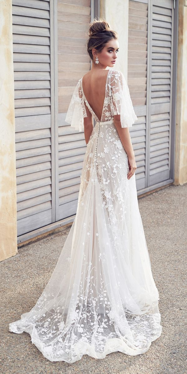 the Amelie Dress is pure romance. A full skirt drapes from waist with deep  neckline and sheer open back bridal gown. Bohemian wedding gown with sleeves 48e2c6cfcad8