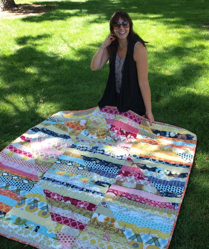 Jelly roll quilt. 8 strips sewn together, squared up, and then cut at a 45 degree angle. Mix up triangle pieces and sew together..