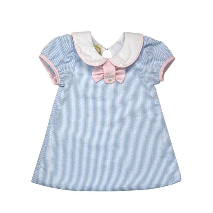 233e919ec8e It s an a-line design with a classic peter pan collar. There is a  Plantation Pink button tab with a sweet and