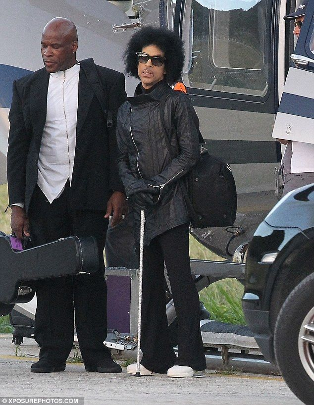 12/31/2015 Eccentric: Prince wore a zip detail leather jacket with a pair of flares, platforms and sunglasses