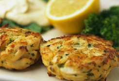 Crab cakes:   Ingredients  1 1/2 pounds crab meat, backfin, cartilage and shells removed  2 tablespoons mayonnaise  2 tablespoons Dijon mustard  3 tablespoons minced onion  1 egg   Directions  Combine all ingredients and shape into 6 patties. Broil 6 inches from heat source, 3 minutes per side, until golden brown. Serve immediately.