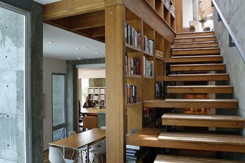 Home tour ruth hasell throughout the house structural elements become decorative features - Staircases with integrated bookshelves ...