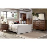 Ashley Burkesville King/Cal King/Queen UPH Sleigh HBD BDRM Set - The warm burnished brown finish flowing beautifully over the frame detailing perfectly enhances the warm inviting rustic design of the Burkesville bedroom collection to create an exceptional addition to the decor of any bedroom.
