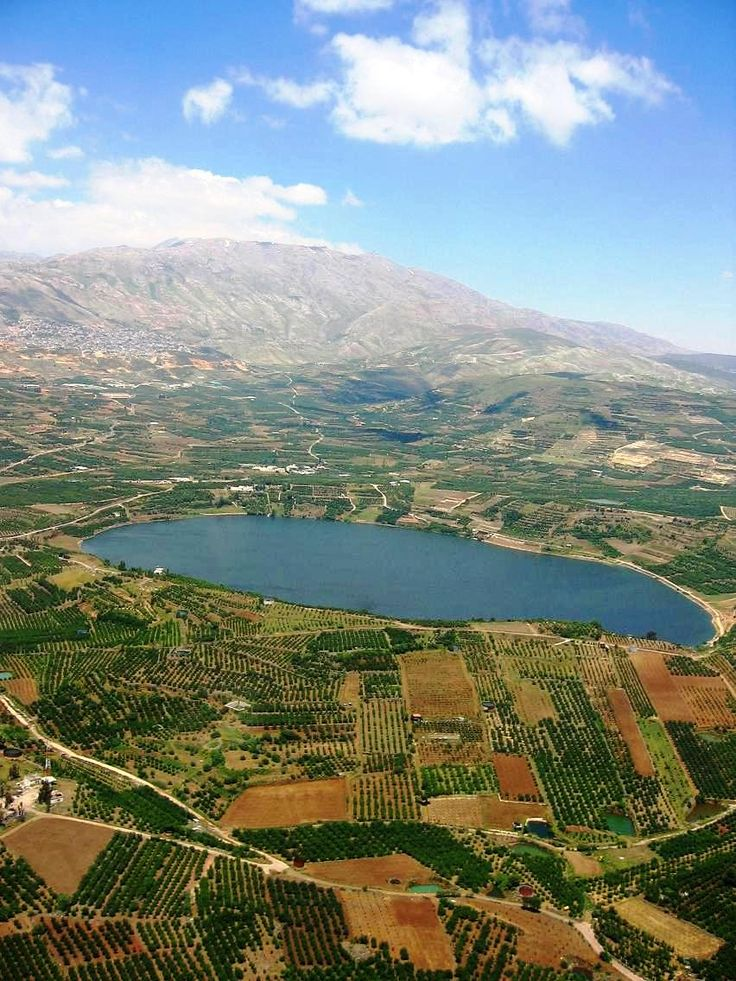 Lake Ram (which is a crater lake) and Mount Hermon, northeastern Golan Heights