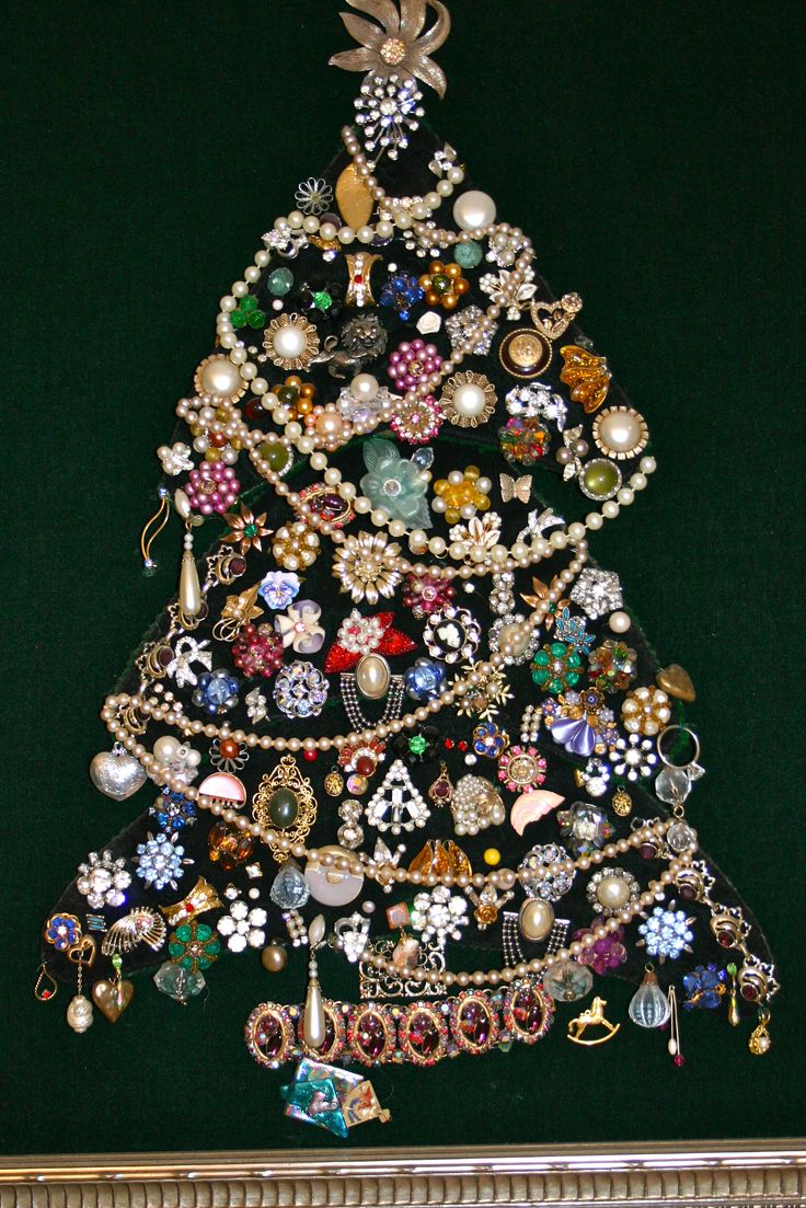 Tree made with old costume jewelry from Mom, Gram, and sisters. You can find cool vintage pieces like this at Goodwill all of the time! Fun!