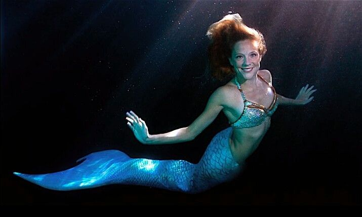 This is Mermaid Linden from Mermaids in Motion. You can hire her to come to your event. No water, no problem. She will come in a tank to your indoor event. www.mermaidsinmotion.com