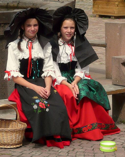 Young girls wearing the traditional dress of the Alsace region of France. Strasbourg, Colmar, and the famous wine route.