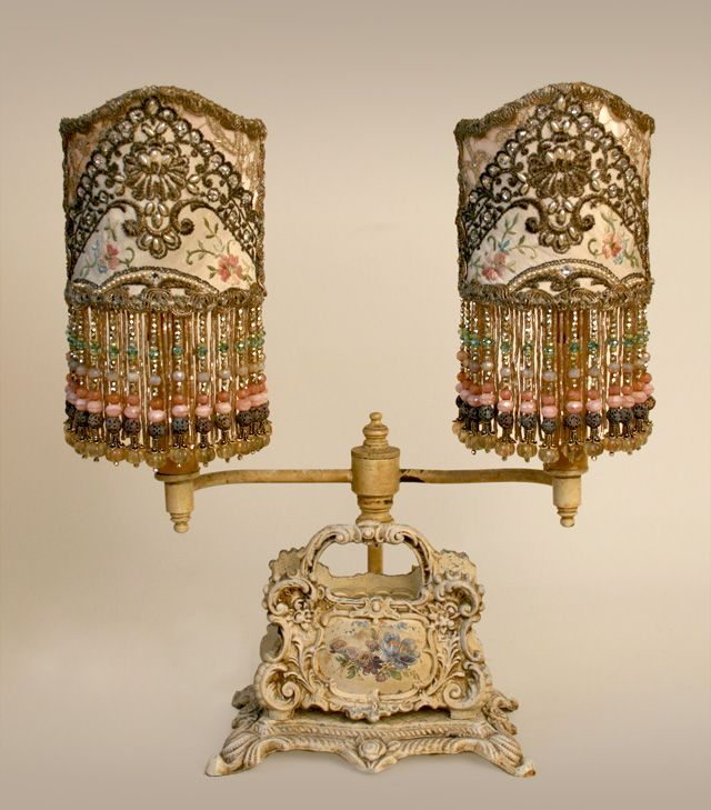 Unique, ornate and shabby antique desk lamp (it even has slots to hold letters!) with a pair or ornate, jeweled beaded cream colored French Shield shades.