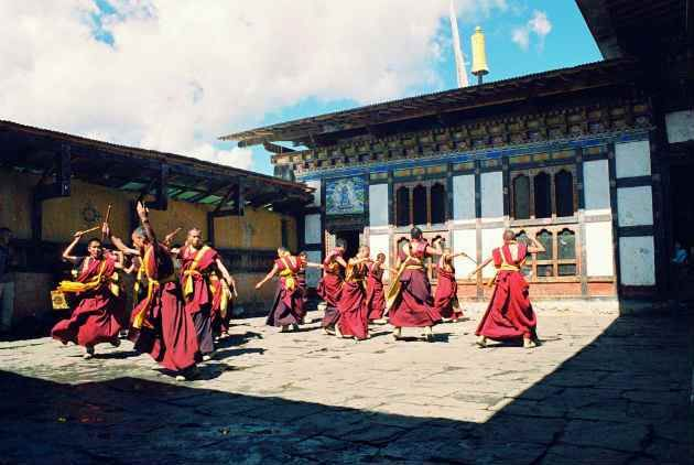 Monks dancing at the Kurjey Lhakhang