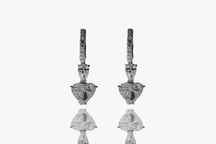 Earrings in white gold 18 Kt with brilliant and heart shape diamonds