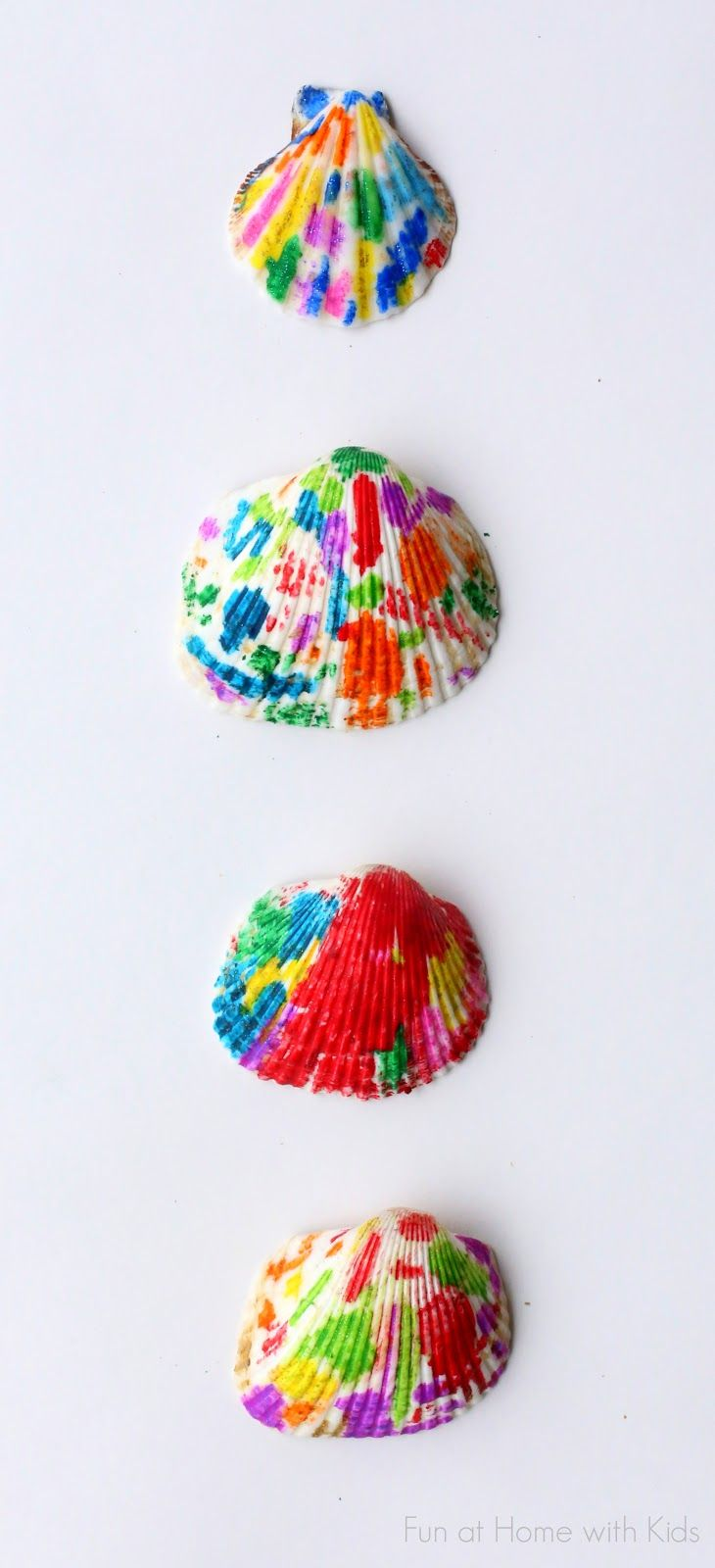 Make beautiful rainbow Melted Crayon Seashells out of shells from the Dollar Store --- or from your travels!
