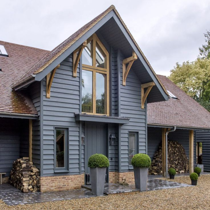 The owner built her dream new-build barn in Oxfordshire and used her favourite colour to create an elegant home inside and out