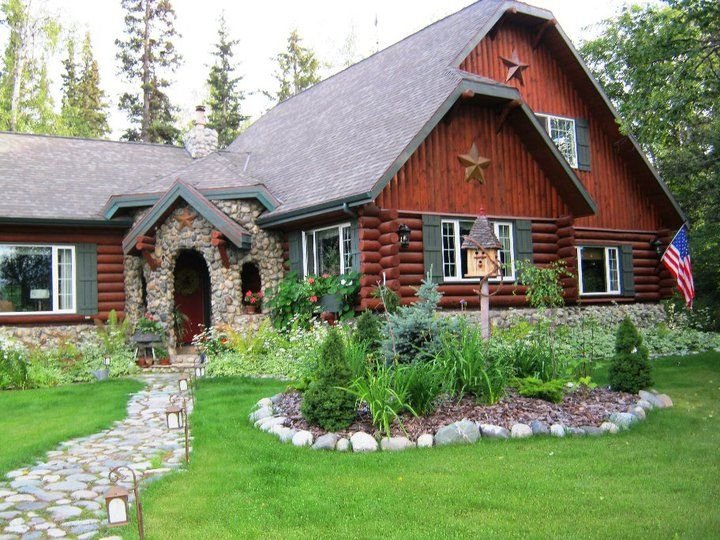 Front View of Alaskan Cabin and yard
