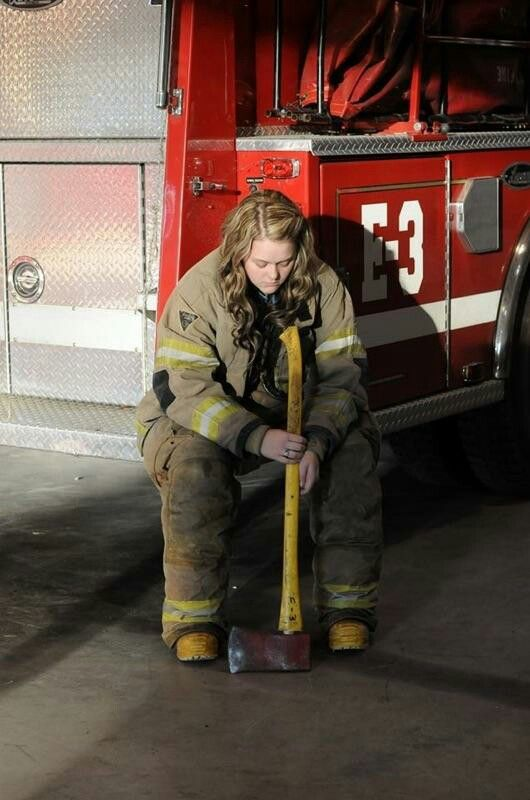 My 18yr old daughters senior pictures. Female firefighter