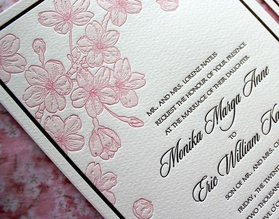 Letterpress invitation with hand illustrated cherry blossoms.