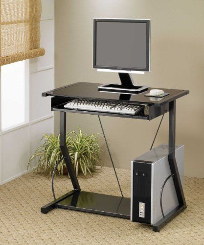 Computer Desk with Pull Out Tray in Black Finish by Coaster Home Furnishings. $78.88. Computer Stand. Metal Computer Desk. Computer Station. Black Computer Desk. Workstation. This simple and compact computer desk will be a nice addition to your home office, or any other space in your home. This desk makes computer use simple, with a generously sized work top for your computer monitor and mouse. Below, a roll out keyboard tray adds to the convenience, with a low spacious shelf al...
