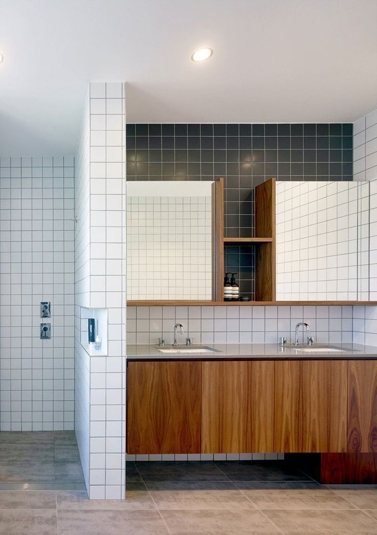 This white tiled bathroom is from a home in brisbane for Bathroom design brisbane queensland