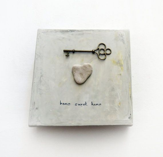 Love is Home  READY TO SHIP Size: 6* 6 inches / 15 * 15 cm Color - off white  This is a mixed media work -acrylic on canvas, and a genuine heart shaped beach rock glued to it. The rock is 100% natural. I find and pick them from the shore of the Mediteranean sea in Israel.  It is READY TO HANG !  This is a great gift for wedding. A beautiful , good vibes decoration for your home  If you have a speacial request, I will customize it for you!  Unique Christmas Gift, Christmas gift for family…