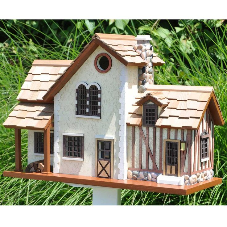 Decorative Birdhouses for $204.99 with Free Shipping! Rustic French Country home birdhouse with stucco details and many windows is small enough to encourage little nesters while keeper larger birds out.