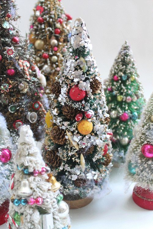 Bottle Brush trees. They are decorated in the most fantastic ways. All have Mercury glass beads but some have jewelry, fruit, pinecones or Santa faces. They are awesome.