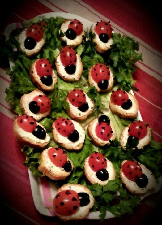 Little ladybug bread / tomato / cheese / black olive made by my dad   Petite coccinelle apéritif avec du pain grillé, fromage type boursin, tomate cerise et olives noires fait par mon père