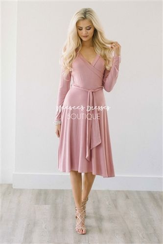 This lovely dress will be your new spring favorite! Comfortable, beautiful and perfect for nursing mothers too! Dusty pink dress features a cross over front, long sleeves and waist tie sash.