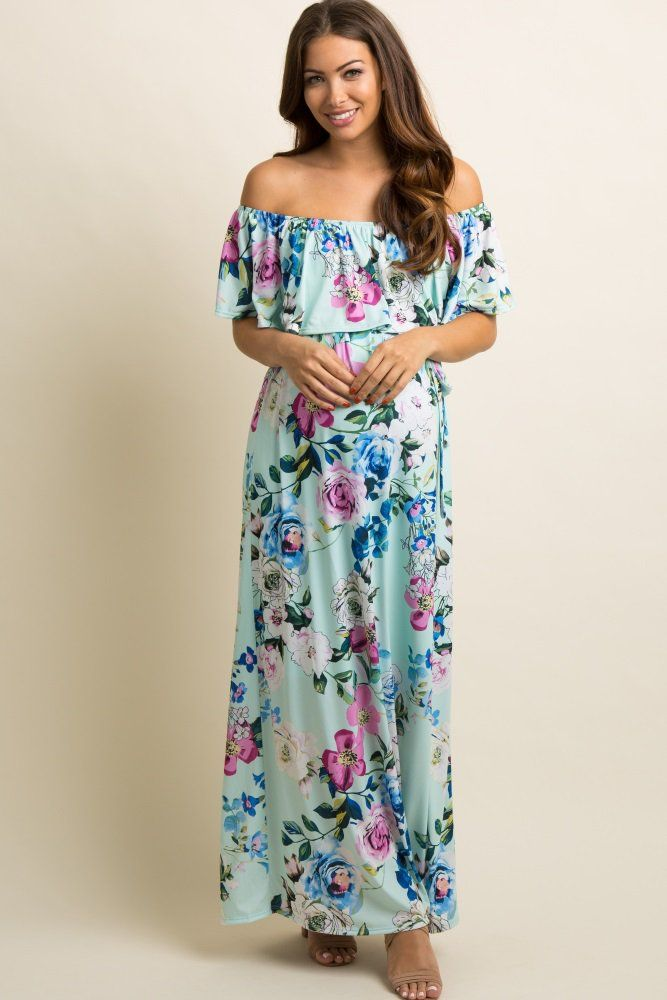 a1ee4d8c5a758 A flowy maternity maxi dress featuring a beautiful floral print and a  cinched elastic off shoulder neckline with a ruffle trim and belt loops  with a sash ...