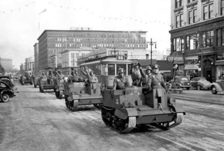 Fake Nazis drove tanks down Portage Avenue, one of the main downtown streets, reminiscent of the Nazis rolling into Paris and other cities. It was part of a staged invasion in Winnipeg, Manitoba on Feb. 19, 1942 called IF Day to scare people into buying more Victory Bonds.