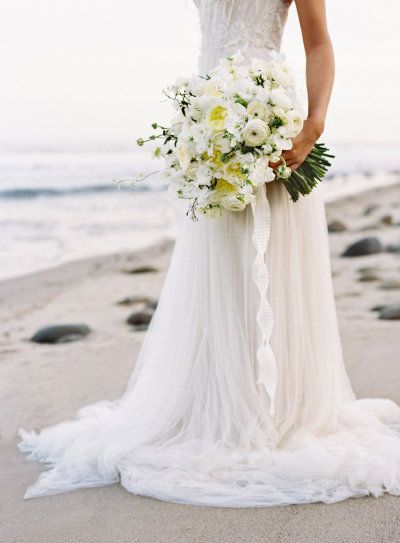 the prettiest yellow and white bouquet   Photography by josevillaphoto.com   Styling and Design by joydevivre.net   Florals by kellykaufmandesign.com   Dress by http://samuellecouture.com     Read more - http://www.stylemepretty.com/2013/07/18/nautical-wedding-inspiration-from-jose-villa-photography/