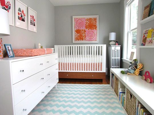 Grey nurseries can be very soothing, but sometimes a little bleak. The pops of vivid colors and blue and white chevron rug in this space give it the little bursts of energy it needs to keep from feeling sad.