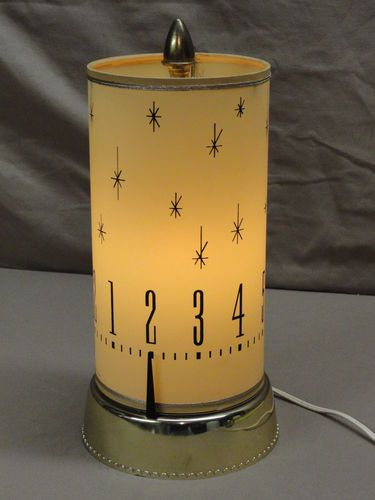 "Revolving motion clock lamp - vers 1960 - This original vintage motion clock lamp is marked ""Spartus Corporation Chicago 12, ill. U.S.A. Model 665----Jul. 25, 1962"" on bottom of base. Clock does work and keeps time with the shade turning"