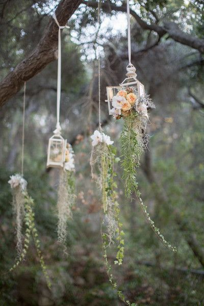 <strong class='info-row'>Kiel Rucker Photography</strong> <div class='info-row description'>Lanterns hung from oversized, oak trees.     Ceremony Venue: SB Museum of Natural History    Event Planner: Jaime Anderson    Floral Designer: Flora Vida</div>