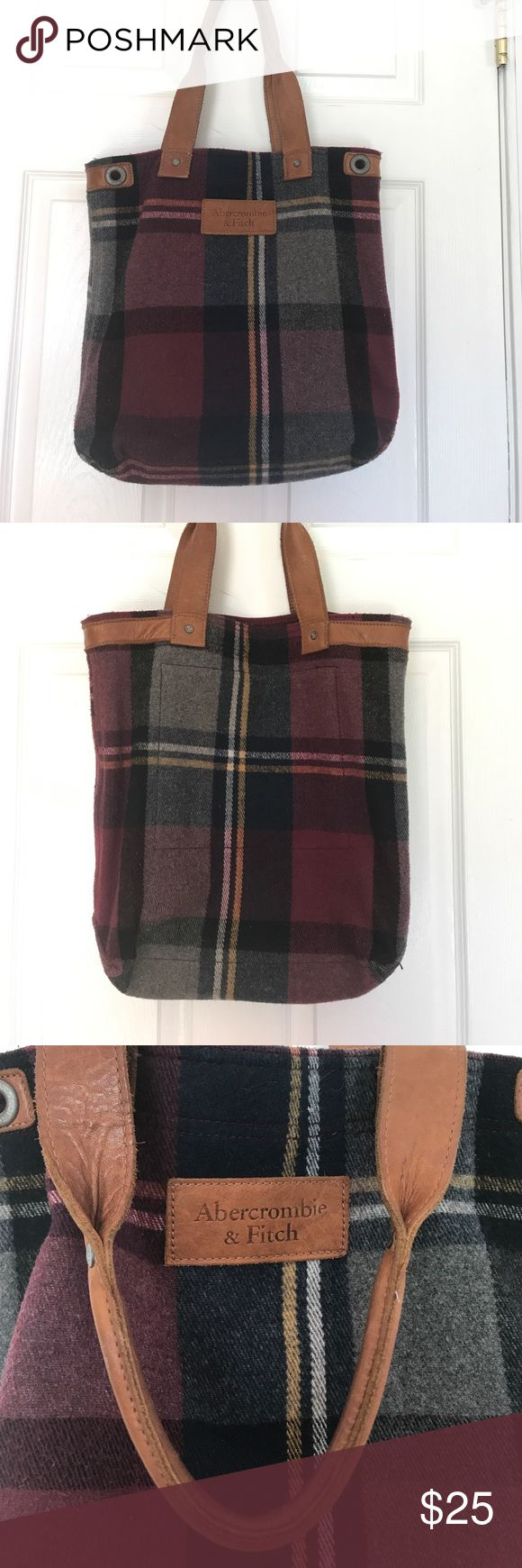 Abercrombie and Fitch wool blanket bag This is a leather and wool blanket large tote bag. So great, durable, sturdy leather straps , navy and burgundy plaid wool blanket exterior. Inside is clean. This bag was used for school, exterior has slight pilling. Bags Totes