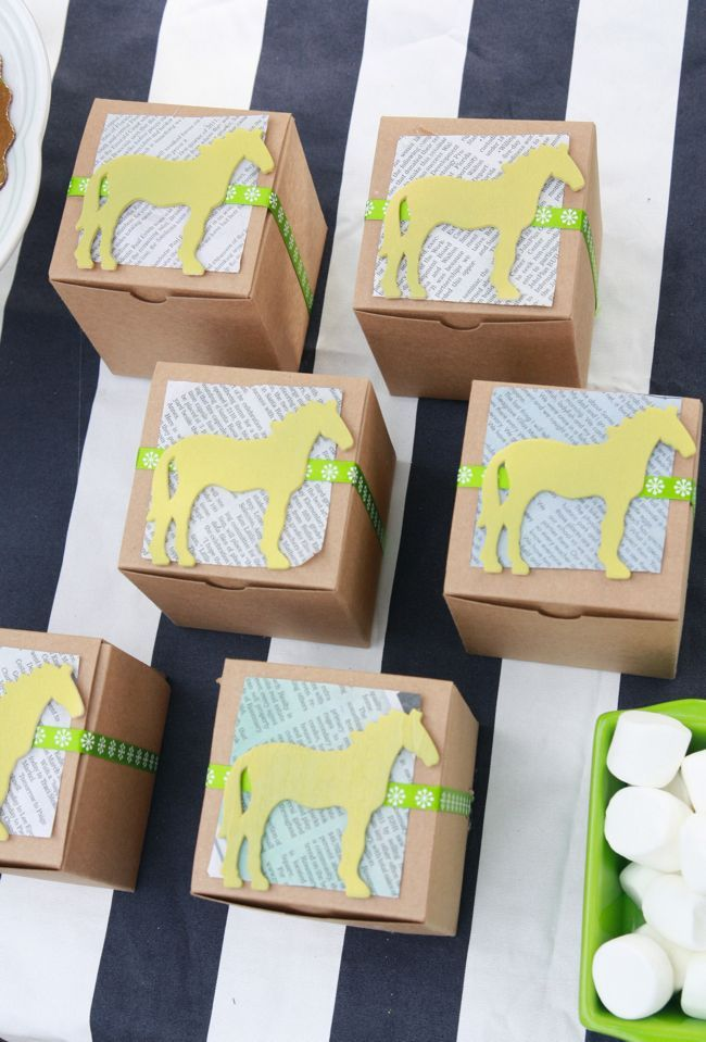 cute party favor- cut little squares of leftover newspaper on diagonal and wrap with ribbon..glue on the wooden horses.