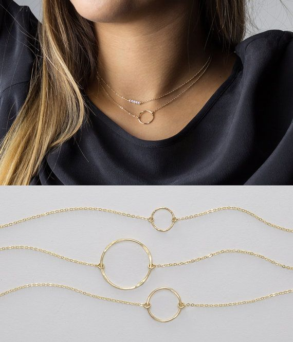 Dainty Open Circle Karma Necklace - choose from 3 sizes - comes in 14k Gold Fill or Sterling Silver. Its simple elegance and versatility will quickly make it your go-to, everyday necklace.   Necklace: KARMA CIRCLE  - High quality 14k gold fill or sterling silver chain and findings. - The suspended circle outline has a subtle hand-hammered texture. - Small Circle: 8mm, Medium: 14mm, Large: 20mm - Made to order at the length you choose - Comes in a beautiful package ready for gift giving…