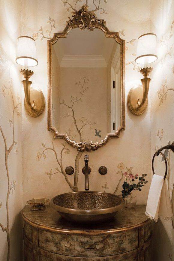 beautiful powder room design featuring brass sconces, Italian Baroque mirror and hand-painted cabinet; powder room decor ideas; powder room lighting; powder room decorating