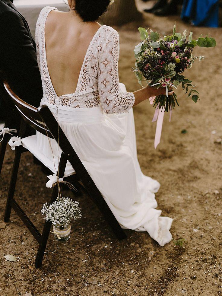 Gypsophila in Glass jars as Chair Decor | Laura de Sagazan boho wedding dress | Destination wedding in Spain | Outdoor ceremony | al fresco dining | Image by Marcos Sánchez | http://www.rockmywedding.co.uk/laura-david/