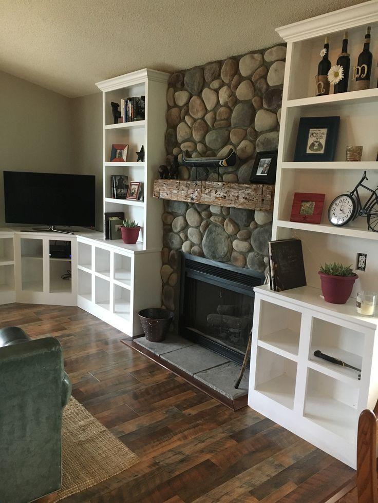 Fireplace remodel  Built in Reclaimed mantel  Pergo max River Road Oak flooring