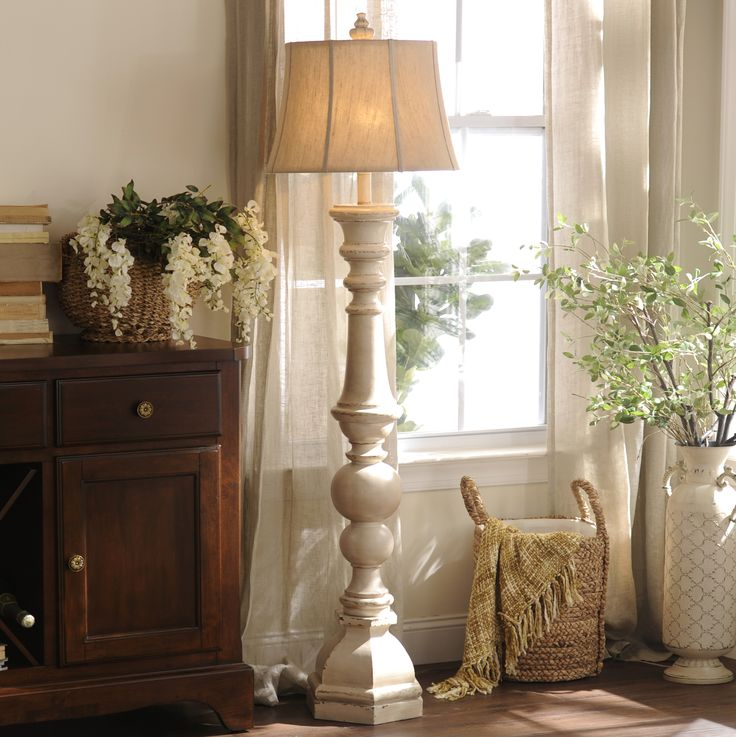 We love the antique feel and beautiful spindle design of the Mackinaw Cream Floor Lamp!